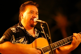 """I left the house this evening to listen to Elmer """"Sonny"""" Lim, an accomplished slack key guitarist who performed on Hawai'i's first Grammy award winning CD, """"Slack Key Guitar, Volume 2"""". Sonny was playing at the Fairmont Orchid's Sunset Terrace on the Kohala Coast of the Big Island. This photo is featured on Sonny's's Wikipedia page, referenced above."""